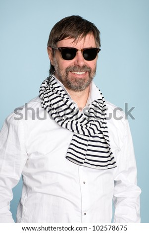 Smiling middle aged man wearing sunglasses - stock photo