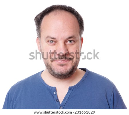 smiling middle aged man with stubble - stock photo