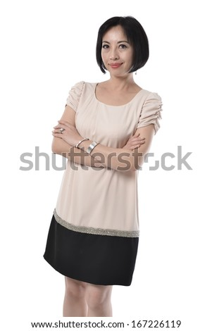 Smiling middle aged woman posing on white background