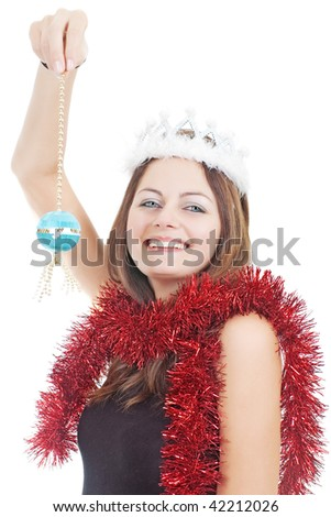 Smiling Miss Santa in white crown holding a Christmas tree ball isolated on white - stock photo