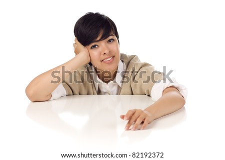 Smiling Mixed Race Young Adult Female Sitting at White Table Isolated on a White Background. - stock photo