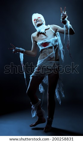 Smiling model posing in mummy costume