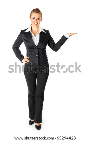 Smiling modern business female presenting something on empty hand - stock photo