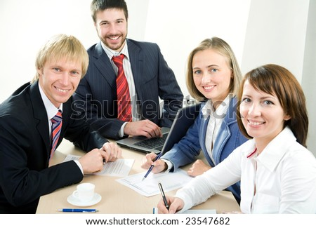 Smiling modern  business people - stock photo