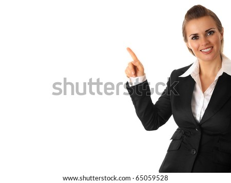 smiling modern business woman pointing finger on isolated on white - stock photo