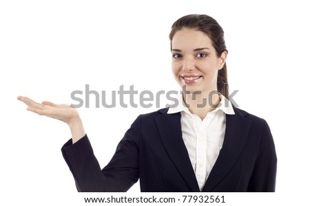Smiling modern business woman presenting a product  isolated over white background