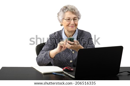 Smiling modern granny calling by mobile during internet conversation