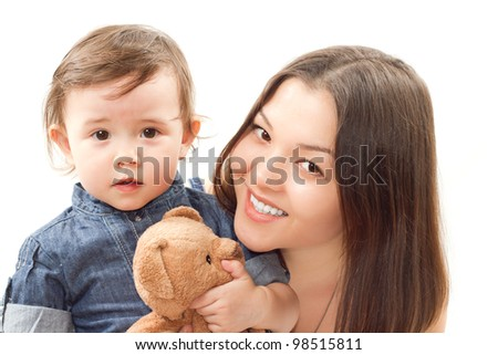 smiling mom and baby girl with toy bear on white background - stock photo