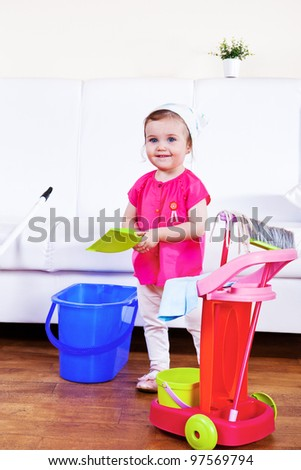 Smiling mom helper cleaning the room - stock photo