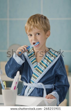 Smiling Morning-Brushing teeth - stock photo