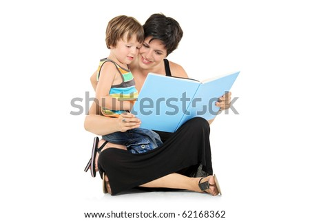 Smiling mother and boy reading a book together isolated on white background - stock photo