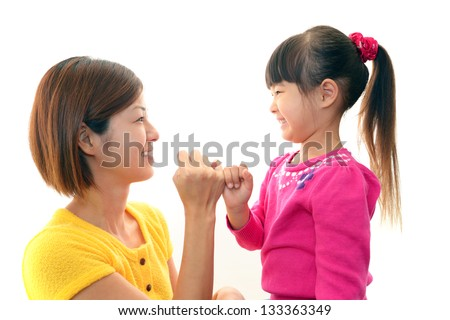 Smiling mother and child - stock photo