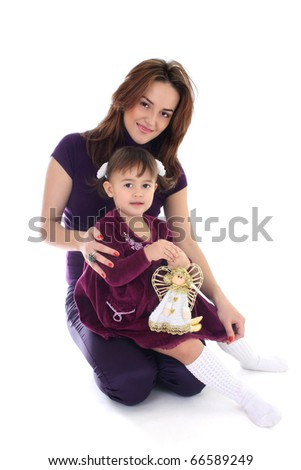 Smiling mother and daughter in violet over white