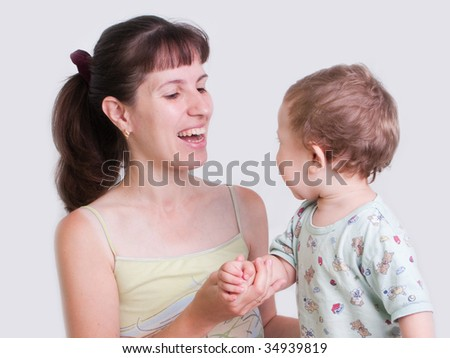 Smiling mother and little child in family happiness