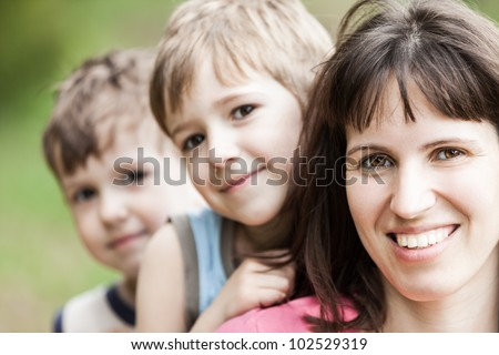 Smiling mother and little sons - family happiness - stock photo