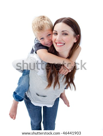 Smiling mother giving her son piggyback ride against a white background