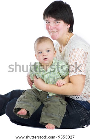 Smiling mother holding her baby isolated on white