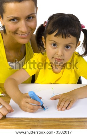Smiling mother sitting with daughter at desk. Writing something with blue marker. Looking at camera, white background - stock photo
