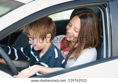 mother teaching son to drive