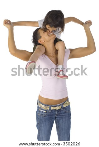 Smiling mother with biting daughter on arms. Isolated on white. Front view, hands up - stock photo