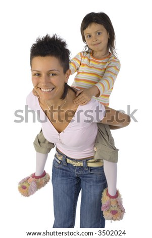 Smiling mother with daughter on back. Isolated on white in studio. Looking at camera - stock photo