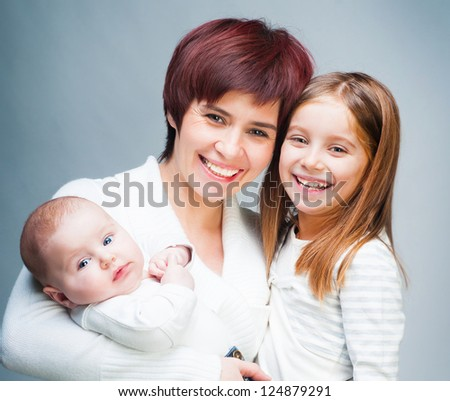Smiling mother with her cute kids - stock photo