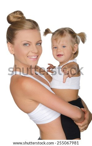 Smiling mother with her daughter in yoga clothes isolated on white - stock photo