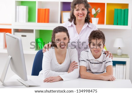 Smiling mother with her son and daughter - stock photo