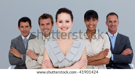 Smiling multi-ethnic business team with folded arms