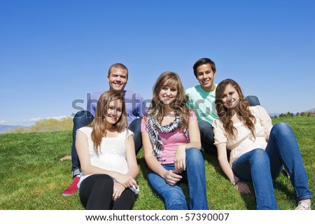 Smiling, Multi-racial group of Young Adults - stock photo