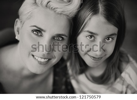 Smiling mum and daughter - stock photo