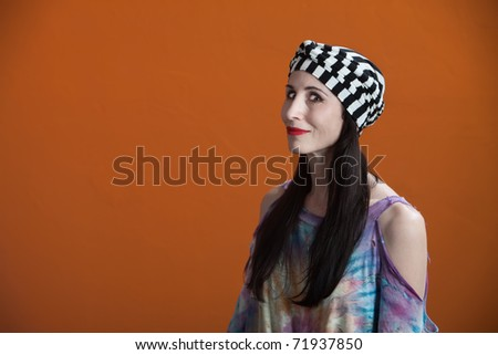 Smiling Native American woman in tie-dye and head-wrap - stock photo