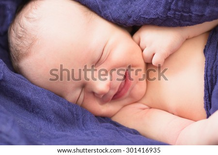 Smiling newborn baby boy - stock photo