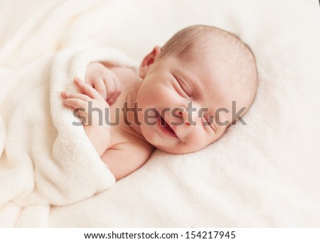 Smiling newborn baby 6 days old - stock photo