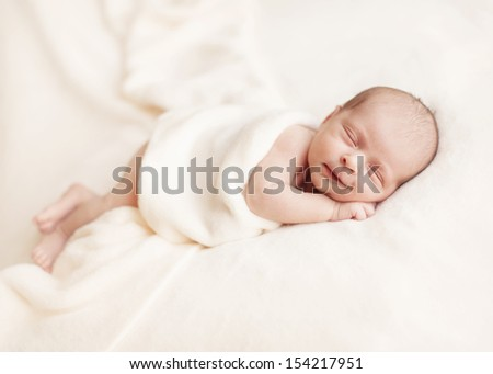 Smiling newborn baby 6 days old
