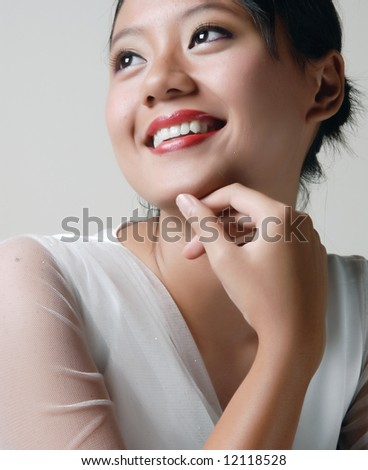 smiling of passion and cheerful beautiful young model poses in white. - stock photo