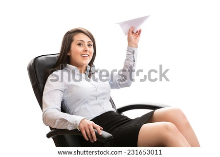 Smiling office worker  with a paper plane - stock photo