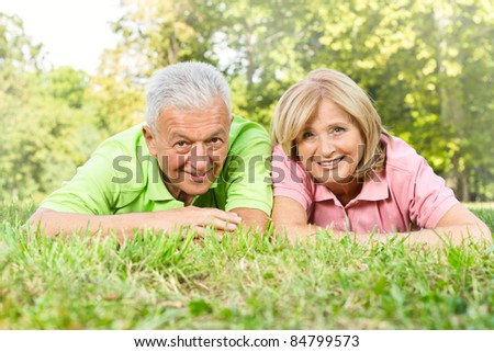 Smiling old people relaxed outdoors.