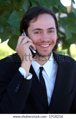 smiling on cell phone - stock photo