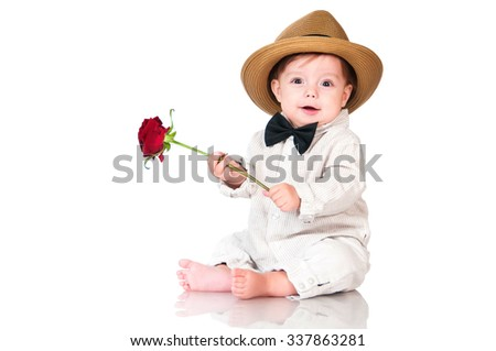 Smiling one old year  boy in retro, bow-tie hat and with red rose sitting on white background. - stock photo