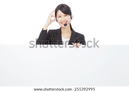 smiling operator OK gesture with Bulletin Board