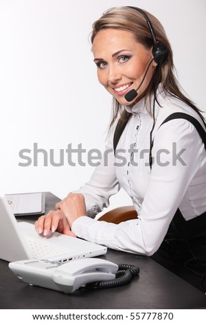 Smiling operator woman in a Call center. - stock photo