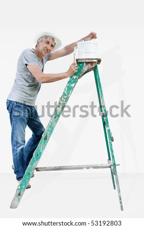Smiling painter on a ladder. - stock photo