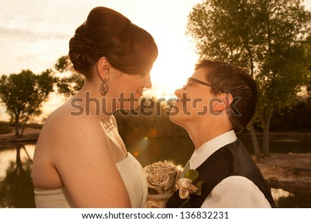 Smiling pair of white lesbian women in marriage ceremony - stock photo