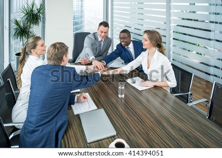 Smiling people in office - stock photo