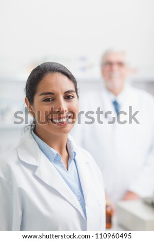 Smiling pharmacist in hospital