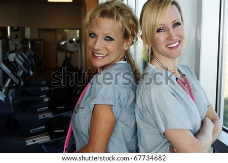 Smiling physical therapist nurses
