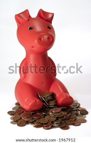 smiling piggy bank sitting in pile of coin