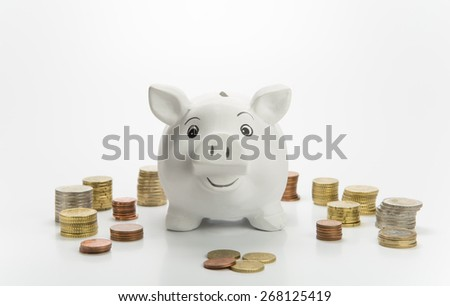 Smiling piggy bank with coins - stock photo