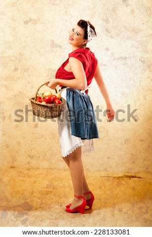 Smiling Pin Up Farmer with Wicker Basket - stock photo